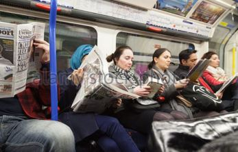 commuters reading