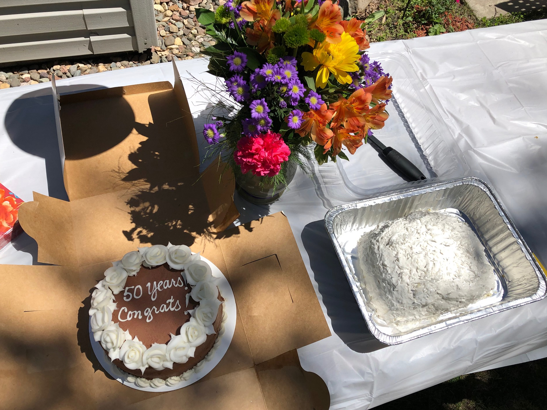 50 year cakes and flowers